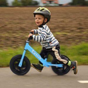 kid with balance bike